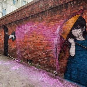 Mural applied to raw red brick, alley next to 104 Bond St Salisbury Boutique [Image - Dunedin Street Art]