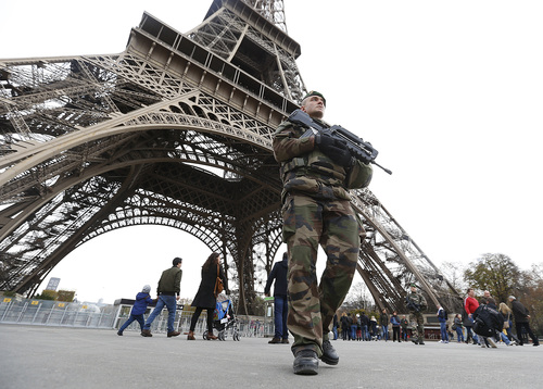 French military patrol near Eiffel Tower the day after a series of deadly attacks in Paris 14.11.15. REUTERS Yves Herman