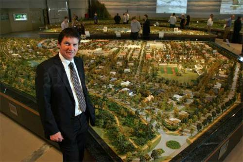 pegasus-bob-robertson-ce-of-infinity-investment-group-with-large-scale-model-of-pegasus-town-feb-2006-teara-govt-nz